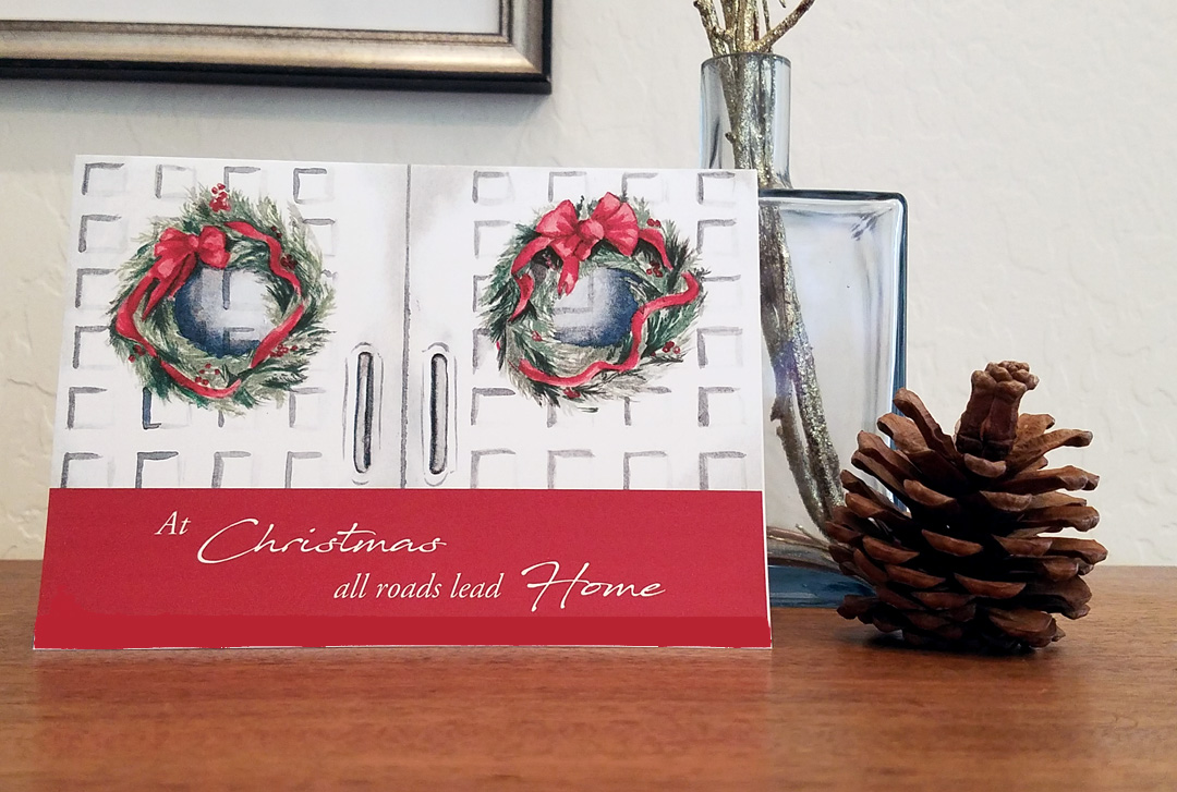 At Christmas, all roads lead home - a pack of 12 Christmas cards with watercolor painted wreaths hung on doors painted by artist Esther BeLer Wodrich