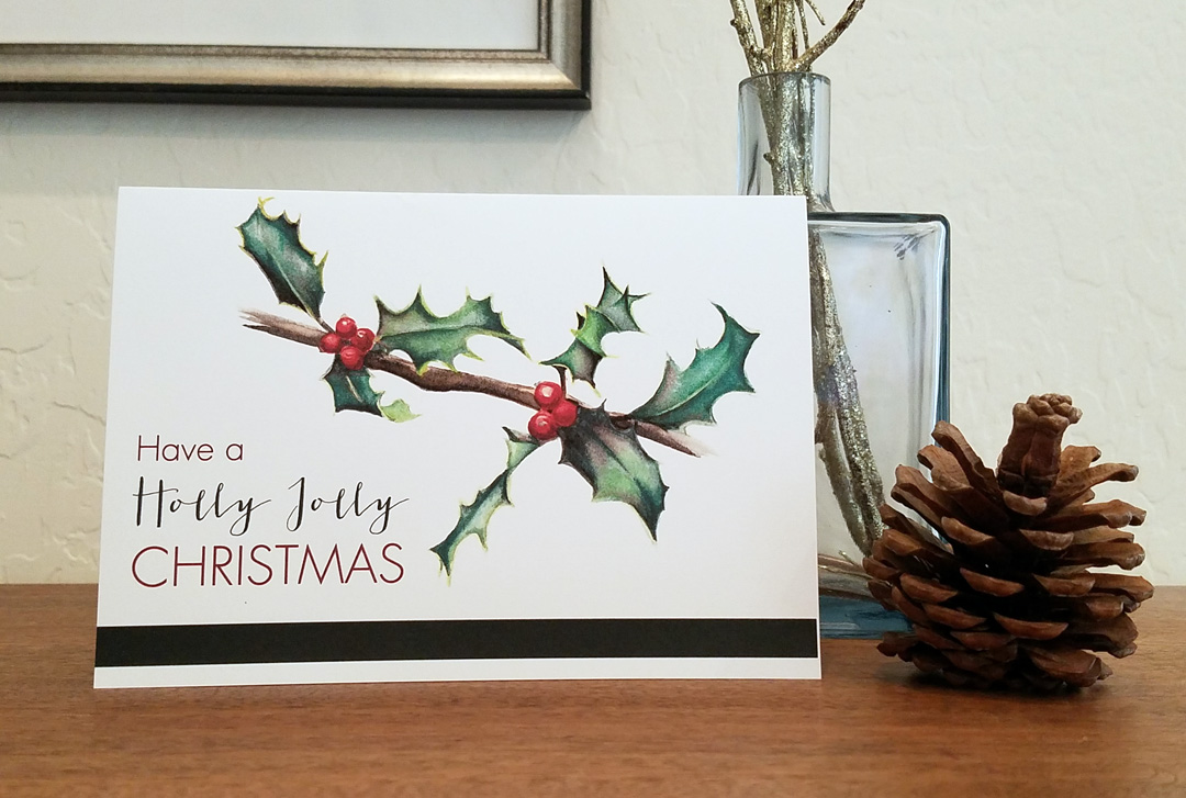 Have a Holly Jolly Christmas card is a painted image of holly leaves printed on premium cardstock by artist Esther BeLer Wodrich