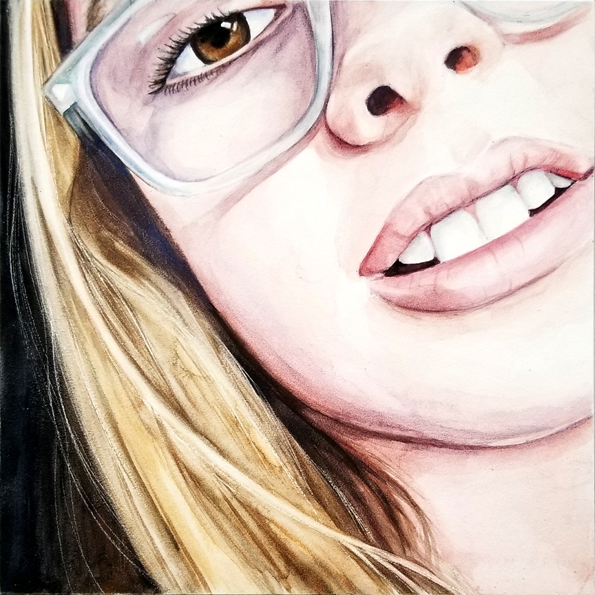 """Close Up"" is a watercolor on aquabord portrait painting of a girl with glasses by artist Esther BeLer Wodrich"