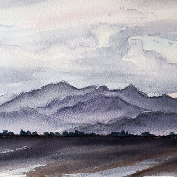 Day 23, 2020 World Watercolor Month painting of White Tank Mountains on a cloudy day by artist Esther BeLer Wodrich